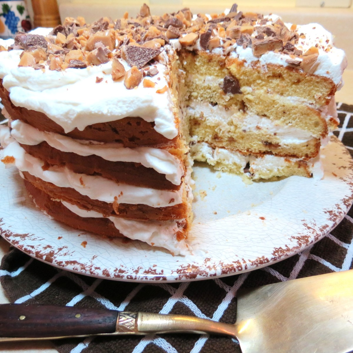 Butter Brickle Cake Frosted with Whipped Cream & Topped with Crushed Milk Chocolate Toffee